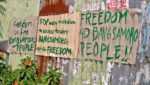 SIGNS OF THE TIMES. Supporters of the Moro Islamic Liberation Front's struggle for self-determination express their sentiments on the government's proposal through messages pasted on walls along some streets in Cotabato City. MIndaNews photo by Toto Lozano
