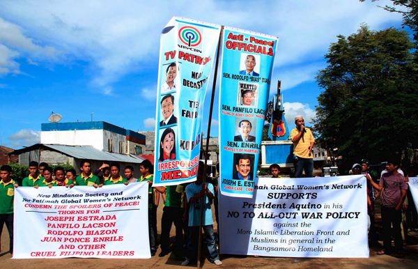 Members of various organizations in Lanao del Sur hold a rally in Marawi City on Monday, October 24, 2011, to denounce Senators Panfilo Lacson and Juan Ponce Enrile, Rep. Rodolfo Biazon and some anchors of TV network ABS-CBN for allegedly feeding on the grief and anger caused by the death of 19 soldiers in Basilan. MindaNews photo