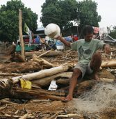 Crying voices heard beneath pile of logs in Iligan coastal village