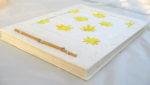 Durian handmade paper album with sunflower design made from durian husk. Photo Courtesy of Katakus
