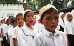 "Students sing the ""Allah Hugaya Tunah"" hymn before the start of the closing rites at the madrasah in Barangay Cuyapon, Kabacan, North Cotabato on July 4, 2012. MindaNews Photo by Ruby Thursday More"