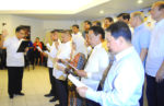 """WELCOME TO LP. Liberal Party president and DOTC Secretary Mar Roxas swears in as new party members the incumbent five governors of the Autonomous Region in Muslim Mindanao Wednesday at the LP headquarters in Quezon City. (R to L) Governors Sakur Tan of Sulu, Sadikul Sahali of Tawi-Tawi, Jum Akbar of Basilan, Mamintal """"Bombit"""" Adiong Jr. of Lanao del Sur, and Esmael """"Toto"""" Mangudadatu of Maguindanao. Behind Mangudadatu is OIC ARMM Governor Mujiv Hataman and Local Governments Secretary Jesse Robredo. (MindaNews photo courtesy of Ali G. Macabalang)"""