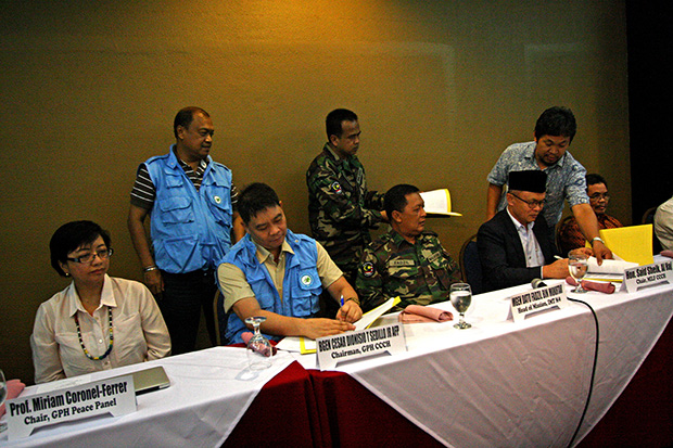 The chairs of the Coordinating Committee on the Cessation of Hostilities (CCCH) of the government Brig. Gen. Cesar Sedillo and Said Sheik, Al Haj of the Moro Islamic Liberation Front (MILF) peace panels signed Monday evening in Davao City a memorandum of understanding on ceasefire-related functions to ensure a peaceful mid-term election.Mindanews Photo by Ruby Thursday More