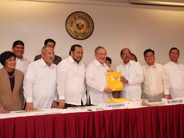 Budget Secretary Florencio Abad (3rd from right) submits the proposed P2.268-trillion National Budget for 2014 to the House of Representatives through Speaker Feliciano Belmonte, Jr. (center) and newly installed Appropriations Committee chair Isidro T. Ungab of Davao City (2nd from right) on July 23, a day after President Aquino's State of the Nation Address. To Ungab's left is Deputy Speaker Pangalian Balindong of Lanao del Sur. Photo by Pecto Camero, Media Relations Service- House of Representatives' Public Relations and Information Bureau (PRIB).