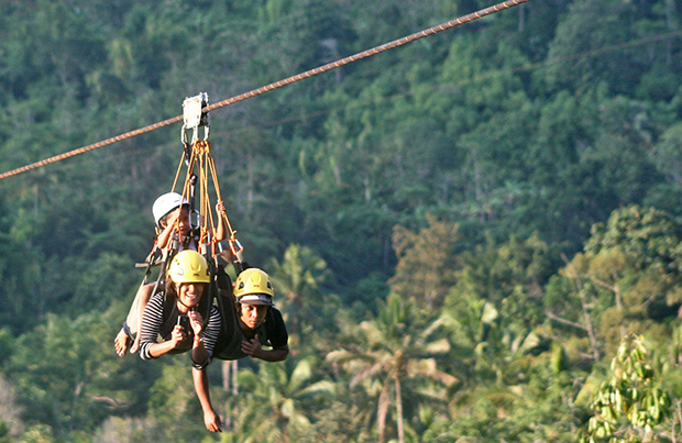 Local tourists try the new zipline in Barangay New Israel in Makilala, North Cotabato Province on Saturday, August 31. The provincial government claims that it is the longest zipline in Asia with a total stretch of 2.3 kilometers. MindaNews Photo by Ruby Thursday More