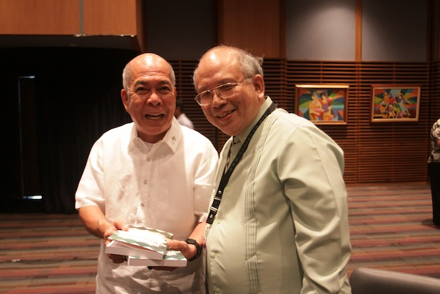 "Davao Arcbishop Romulo Valles (left) receives from Ateneo de Davao University President Joel Tabora the two-volume book, ""Bangsamoro: Documents and Materials"" which the university published in partnership with MindaNews. Photo courtesy of IPO ADDU"