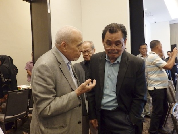 Sayed El-Masry, OIC Special Envoy for Peace in the Southern Philippines converses with MILF peace panel chair Mohagher Iqbal after the four-hour meeting convened by the OIC Secretary-General. MIndanNews photo by Carolyn O. Arguillas