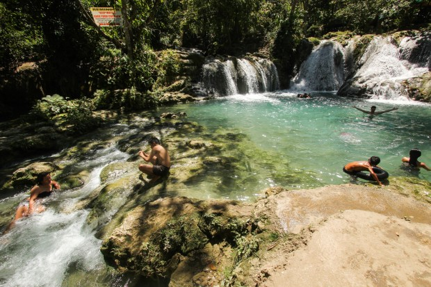 Tourists take a dip to beat the summer heat at Hagimit Waterfalls Resort on Wednesday (1 April 2015) in Barangay Peñaplata in Samal Island, Davao del Norte. The nature resort is one of the tourist attractions in the island. MindaNews photo by Keith Bacongco
