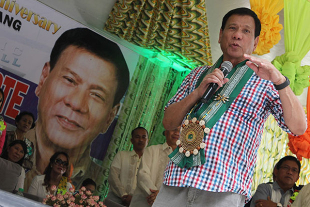 Davao City Mayor Rodrigo Duterte at the 64th founding anniversary of M'lang in North Cotabato on Monday, August 3. MindaNews photo by TOTO LOZANO