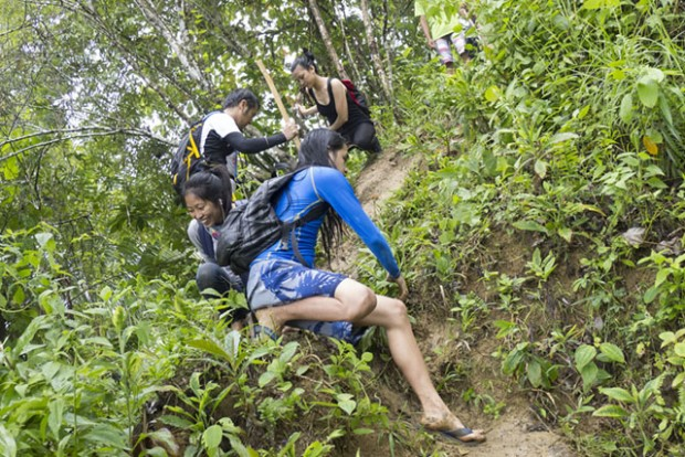Climbing down the mountain from Hindang Cave during a rain is a challenge, with the muddy trail. MindaNews photo by Bobby Timonera