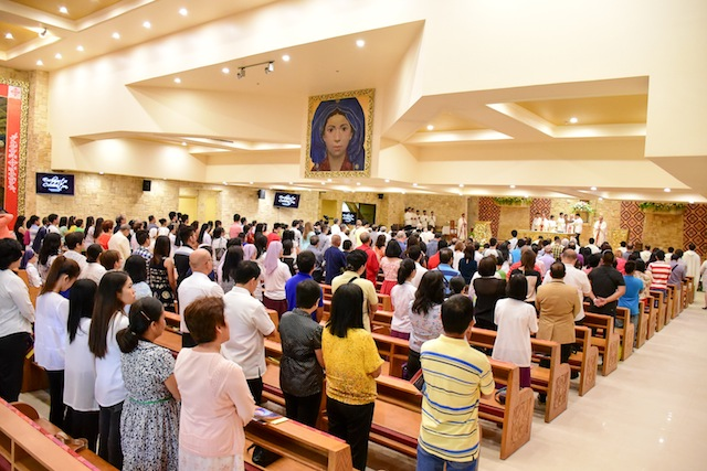 Guests attend mass during the blessing of the University Chapel of Our Lady of the Assumption at the Ateneo de Davao University Jacinto campus. Photo courtesy of Igy Castrillo