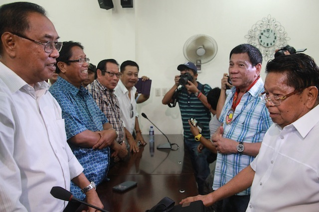 Ghazali Jaafar, 1st Vice Chair of the Moro Islamic Liberation Front (right) introduces the other members of the MILF Central Committee to presidential candidate and Davao City mayor Rodrigo Duterte during his visit in Camp Darapanan, Sultan Kudarat town in Maguindanao on February 27, 2016. MindaNews photo by TOTO LOZANO