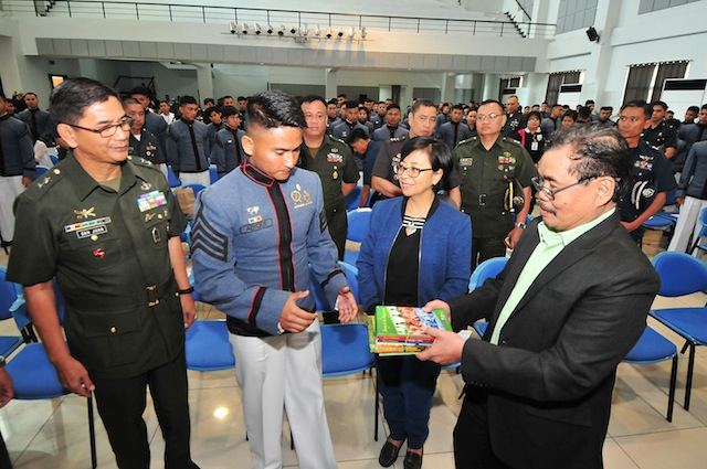 Government and MILF peace panel chairs Miriam Coronel-Ferrer and Mohagher Iqbal hand over some books on the Bangsamoro and the Bangsamoro peace process to Philippine Military Academy (PMA) Superintendent Maj. Gen. Donato San Juan III and this year's top PMA graduate, Kristian Daeve Gelacio Abiqi during a forum on the Bangsamoro peace process on March 9, 2016 at the PMA in Baguio City. MindaNews photo by FROILAN GALLARDO