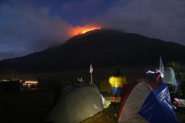 A group of mountaineers and bikers from Cotabato City watched the fire at the peak of Mt. Apo in this photo taken at 4:59 p.m. on Saturday (26 March 2016), as they set up tent in the camping site beside Lake Venado. The Cotabato group claimed three unidentified mountaineers who slept at the peak and cooked there may have caused the fire. Photo courtesy of TUTIN SAPTO / Cotabato All-Terrain Bikers Association (CATBA)