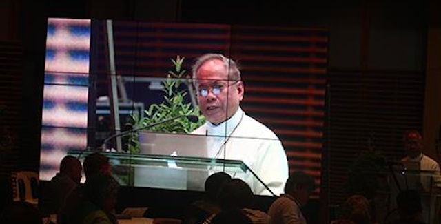 Cardinal Orlando B. Quevedo, OMI, delivers the keynote address at the Titayan: Briding for Peace symposium held at the Ateneo de Davao University on 21 April 2016. MIndaNews photo by KEITH BACONCGO