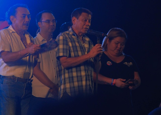 "WARNING. President-elect Rodrigo Duterte delivers a 32-minute thanksgiving speech at the ""One Love, One Nation"" party at the Crocodile Park in Maa, Davao City Saturday night, June 4. The speech, still laced with expletives and warnings, was cut short due to the rains. MindaNews photo by TOTO LOZANO."