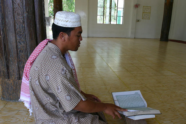 A Muslim prays at the Sheikh Karim-ul Makhdum Mosque, the first mosque in the Philippines built aound 1380. The pillars of the original mosque, built by the Arab trader from whom the mosque was named after, are still intact, as shown in the background in this picture taken in 2004. Local residents celebrate the 636th anniversary of the mosque's construction on Monday (7 Nov 2016). MindaNews photo by BOBBY TIMONERA