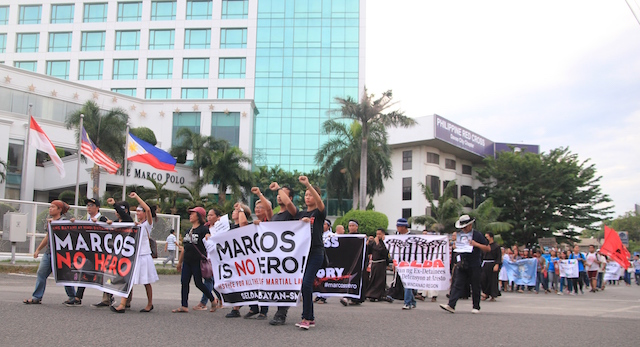 In Davao City, protesters did a quick march in the vicinity of the Freedom Park Friday before speakers took turns expressing their rage against the burial of the deposed dictator Ferdinand Marcos at the Libingan ng mga Bayani on Nov. 18. MindaNews photo by GREGORIO BUENO