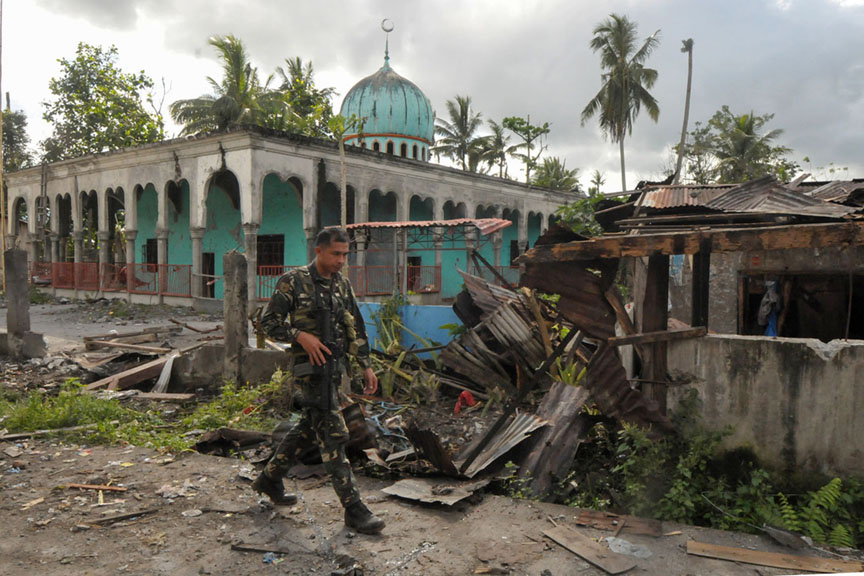 A soldiers walks past a bombed-out mosque in Butig, Lanao del Sur after government troops retook Butig town from the Maute group. MindaNews photo by Froilan Gallardo