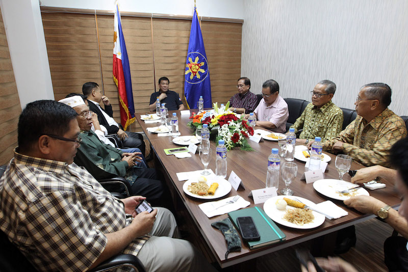 President Rodrigo Roa Duterte presides over a meeting with the Moro Islamic Liberation Front (MILF) delegation led by its chairman Al-Hajj Murad Ebrahim and Presidnetial Peace Adviser Jesus Dureza at the Matina Enclaves in Davao City on December 2, 2016. ROBINSON NIÑAL/Presidential Photo