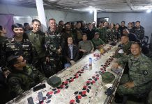 President Rodrigo Duterte visits troops in Marawi on 21 September 2017, Day 122 of the Marawi Crisis. This is his fifth visit to Marawi since the armed clashes with the Maute Group started on May 23. Accompanying the President were Defense Secretary Delfin Loorrenzana, Presidential Adviser on Military Affairs Arthur Tabaquero, Armed Forces of the Philippines (AFP) Chief of Staff General Eduardo Año and Special Assistant to the President Christopher Lawrence Go. The President also tagged along Paolo Santos, Jimmy Bondoc and Arnel Ignacio to provide entertainment to the troops. Richard Madelo / PRESIDENTIAL PHOTO