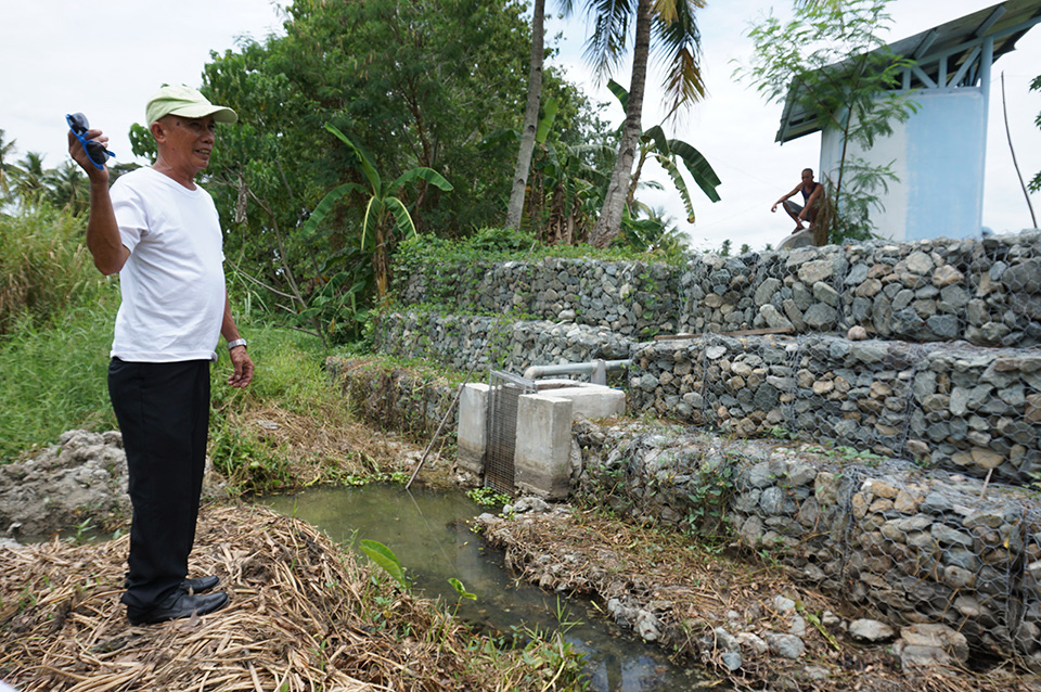 Kagawad Danilo Casa of Brgy. Biwang, Bagumbayan, Sultan Kudarat shows the intake structure with gabions of the solar-powered irrigation project site in his brother's farm. Mindanews Photo by H. Marcos C. Mordeno